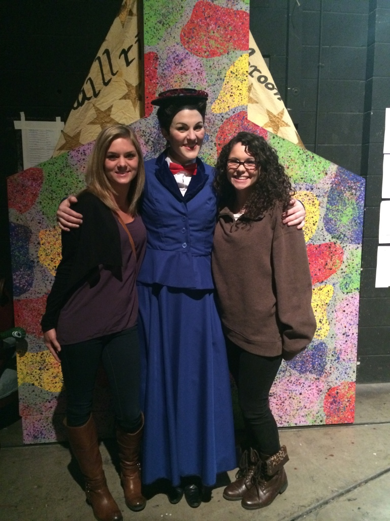 Julia O'Malley and Maddie Meier take fan photos with Mary Poppins after the show